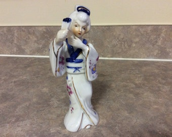 Lovely Japanese Geisha Girl Figurine with a Fan in Her Hand.