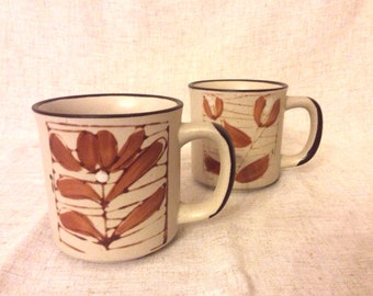 Two stoneware mugs
