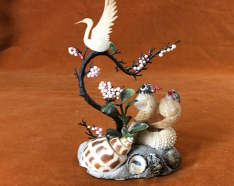 Vintage seashell art with birds and plastic foliage