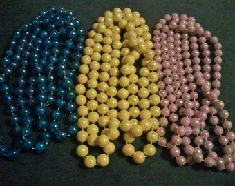 """Three glossy extra-long 54"""" vintage beaded necklaces - 1950s - pink, yellow, blue"""