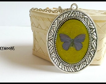 Necklace with resin pendant; butterfly