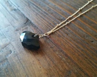 Black Crystal Leaf suspended from Gold Filled Chain on Satellite Necklace