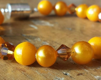 Tangerine vintage pearl, glass Czech beads, and Swarovski crystal stacking stretch beaded bracelet