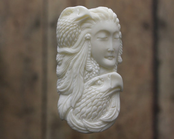 Spirit lady bone carving eagles feathers symbol of power