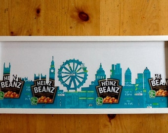 The London Skyline finely cut out of real Baked Bean labels on a white background, frame not included.