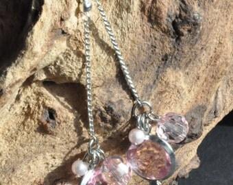Long drop earrings in pink