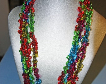Beautiful, vibrant colored, lightweight crocheted necklace.  Adjustable length