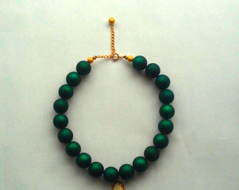 Emerald green rubber bead necklace with framed vintage resin cameo
