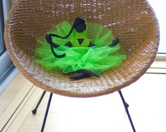 Black ballerina with a lime green tutu