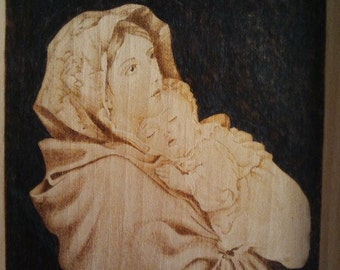 Madonna and child, pyrography on wood panel