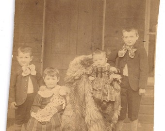 Little girl with doll and brothers toy outdoor family baby antique photo