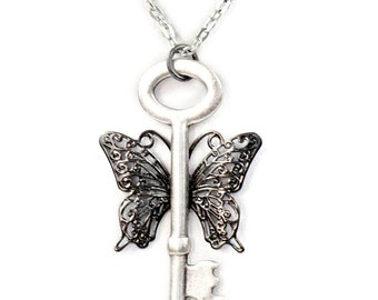 Steampunk Winged Gunmetal and Antiqued Silver Necklace with Skeleton Key and Dark Filigree Wings by Velvet Mechanism