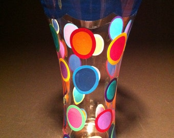 Navy blue vase with colorful polka dots
