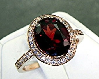 AAA Pyrope Red Garnet   10x8mm  3.07 Carats   in a 14k ROSE gold ring with diamonds (.32ct) Ring 1137
