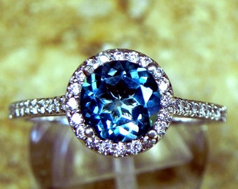 AAAA Natural London Blue Topaz Round   7.00mm  1.50 Carats   in 14K white gold Halo ring with .30 carats of diamonds MMM