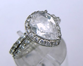 AAA Natural White Topaz Pear shape untreated   10x7mm  1.59  Carats   in 14K White gold bridal set with .40cts of diamonds. MMM