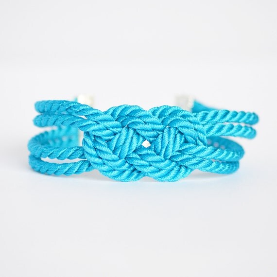 Bright turquoise blue double infinity knot nautical rope bracelet with silver anchor charm
