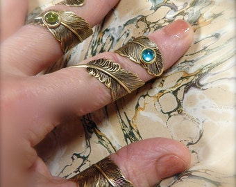 Feather Ring with a Jewel Set Dew Drop