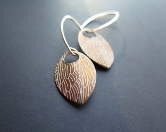 feather earring in anodized aluminum. sterling silver dangle earrings in copper.