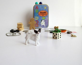 Tiny toys with new and vintage items in a little tin box. Learning toys, sensory toys, busy box.