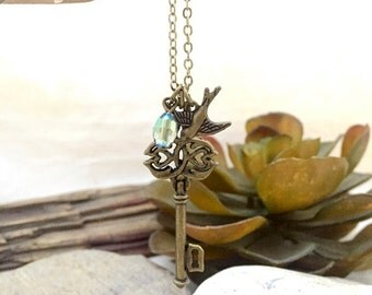 Ornate Bronze Key Necklace with Bird and Crystal Accent
