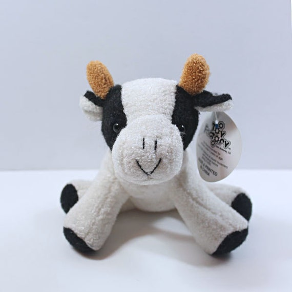 Small Toy Cows : Vintage small stuffed black and white toy cow factory