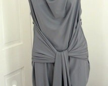 Gray spandex low back dress with cowl neck and drape tye