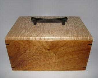 """Canarywood and Tiger Maple Lift-Top Box. 10"""" x 7"""" x 5""""."""