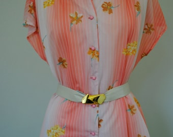 a vintage 70s bright peach floral print button down top blouse. sz large or x-large.