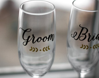 Personalized Wedding Toasting Flutes, champagne glasses personalized with wedding date for bride and groom. Calligraphy wedding idea