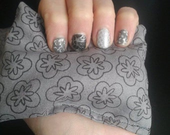 Small grey rice bag to help apply heat activated nail wraps