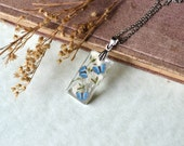 SALE Pressed Baby's Breath Flowers with Tiny Blue Butterflies Resin Pendant