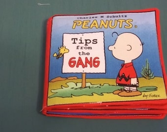 """Peanuts 'Tips from the Gang"""" cloth baby book"""