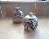 two small pottery vases pretty gray brown colors. One  marked Inarco Japan use coupon code FIFTYOFFSALE for 50% off