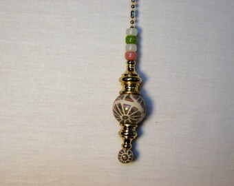 26mm Hand-Caned Clay Bead w/ bottom bead to match