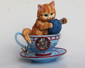 JURGEN SCHOLZ  Kitten in a tea cup Orange Tabby Cat with Paw Prints Playing with Yarn