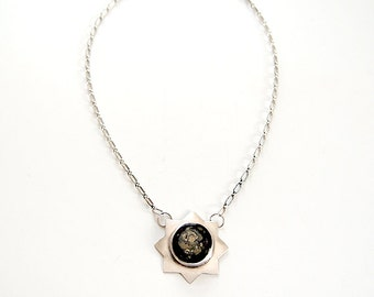 Recycled silver eight pointed star necklace with black and tan ceramic center - Hoag Necklace