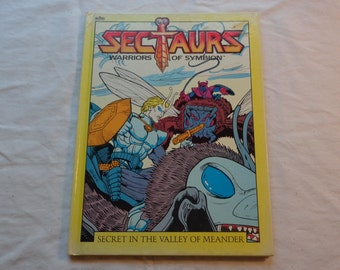 """Vintage 80's Kids Book, """"Sectaurs: Secret In the Valley of Meander"""" by Sonia Black, Illustrated by Steven Geiger & Roberta Edelman, 1985."""