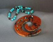 Red Horsehair koru pendant with turquoise embellishments and gemstone necklace