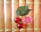 Gorgeous handmade deep red cherry and leaf hair clip by Rosie Alia Designs - vintage inspired, rockabilly cherries hair flower