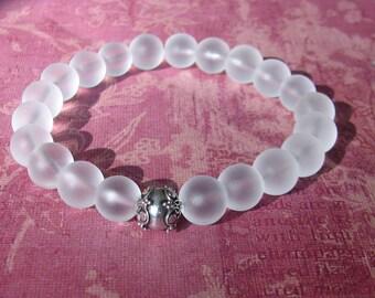 10mm Matte Clear Quartz stretch bracelet with a Sterling Silver Bali Bead