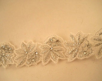 LACE:  SILVER and WHITE bridal trim, 1 1/8 inches wide, metallic thread and small rhinestones.  Per yard pricing.