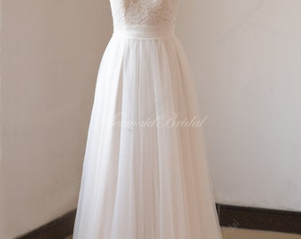 Romantic ivory pale blush lining A line lace tulle wedding dress with illusion neckline