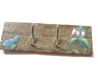 Reclaimed wood wall rack. Wood rack. Farmhouse chic wall coat rack. Coat hook rack. Floral design. Rustic.Two metal vintage hooks.