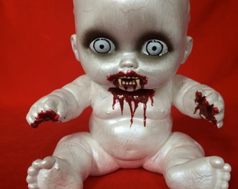 Ray Venous is a OOAK vampire baby art doll