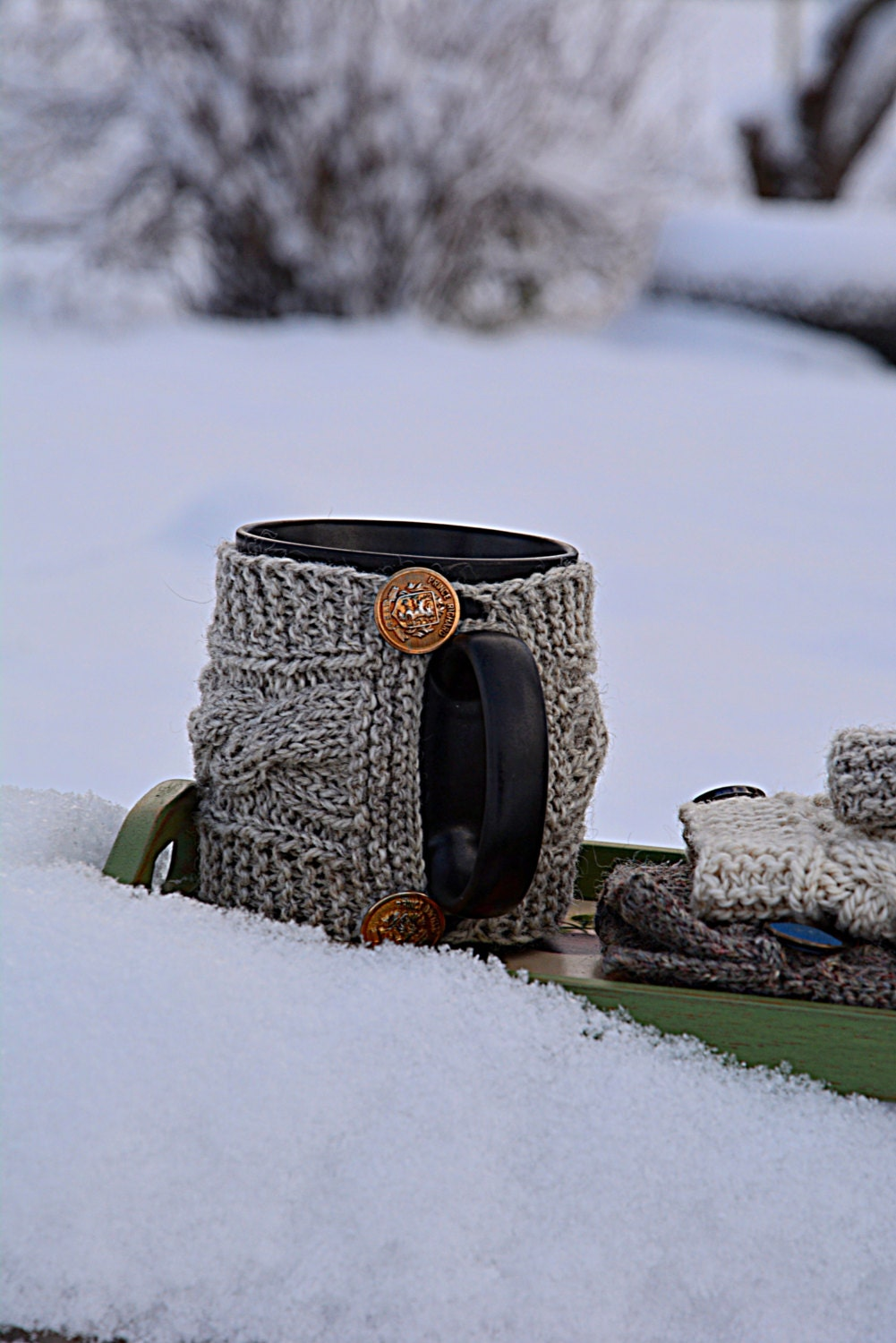 Knit coffee mug cozy with cable pattern. Grey cup cozy