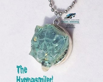 "Authentic movie artifact necklace made with ""It's a Mad, Mad, Mad, Mad World"" car glass."