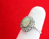 Oval Opal with Diamond Halo in 14K Gold