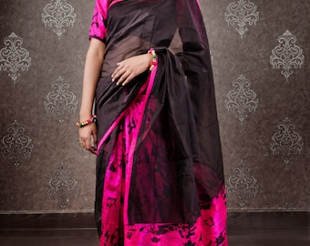 Black Chanderi Saree with a beautiful hot pink elephant print in the pleates and blouse sleeves