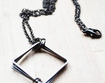 Men's handmade african boho tribal necklace. Dual Pyramids, triangle geometry brass covered adjustable gunmetal grey. Handmade in Australia.